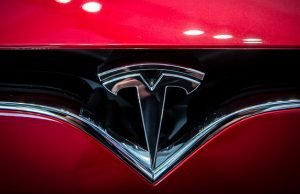 Tesla announces additional losses as its shares drop